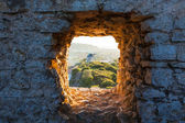 Old Windmill through Window in Fortress Wall — Stock Photo
