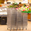 Stock Photo: Shiny Metal Shopping Basket Stacks