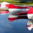 Red and White Canoes and Boats — Stock Photo