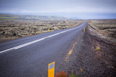 Highway through Iceland landscape at foggy day — Stock Photo