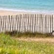 Wooden fence at Northern beach in France — Stock Photo