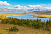 Iceland Landscape with River, Mountains and Bright Blue Sky — Stock Photo