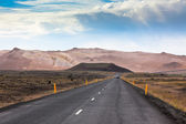Highway through Iceland Mountains landscape — Stock Photo