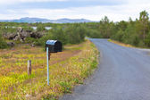 Old Weathered Mailbox at Rural Roadside in Iceland — Stock Photo