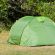 Outdoor Green Tourist Tent at Field - Stock Photo