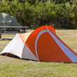 Outdoor Tourist Tents at Camping Field - Stock Photo