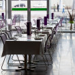 Indoor restaurant tables ready for service — Stock Photo