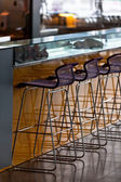 Empty row of stools at a bar — 图库照片