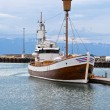 Typical Iceland Harbor with Wooden Ship at Overcast Day - Stock fotografie