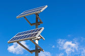 Solar panels on bright blue sky background — Stok fotoğraf