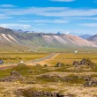 Highway through Mountains Icelandic landscape — Stock Photo #24470495