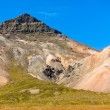 Icelandic mountain landscape under blue summer sky — Stock Photo #24485695