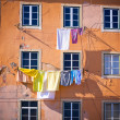 Washing hanging outside an old building of Lisbon, Portugal — Stock Photo #24876869