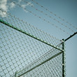 Razor and barbed wire fence - Stock Photo