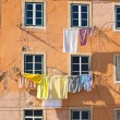 Washing hanging outside an old building of Lisbon, Portugal — Stock Photo #25017447