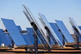 Solar panels on bright blue sky background — Stock Photo