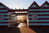 Ocean beach huts at evening sunlight — Stock Photo
