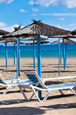 Lines of Parasols at Spanish Sand Beach — Stock Photo