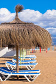 Line of Parasols at Spanish Sand Beach — Stock Photo