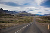 Highway through Iceland landscape at overcast day — Stock Photo