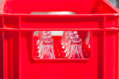 Red Plastic Crate with Empty Glass Bottles — Stock Photo
