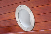 Wooden Ship porthole. View from outside — Stok fotoğraf