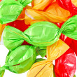 Candy in colored wrapper isolated on white — ストック写真
