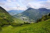 Hang glider pilot in Swiss Alps taken in summer, — Stock Photo