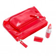 Beautiful red makeup bag and cosmetics isolated on white — Stock Photo #12798270