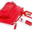 Stock Photo: Beautiful red makeup bag and cosmetics isolated on white