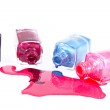 Bottles with spilled nail polish over white background  — Stock Photo #13251673