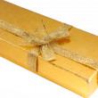Golden gift box with golden ribbon — Stock Photo