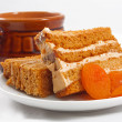 Sweet honey-cake with dried apricots — Stock Photo