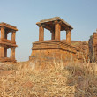 Fort atop rocky mountain and cave temples at Badami, Karnataka, India, Asia - Stock Photo