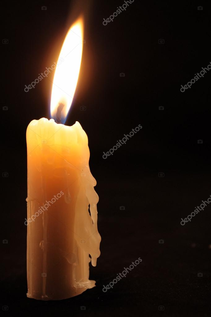 Old candle on the black background   Stock Photo #13616360