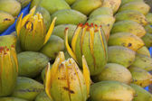 Close up of green mango on market stand, India — Stock Photo