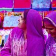 Lady in violet, covered in paint on Holi festival — Stockfoto