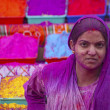 Lady in violet, covered in paint on Holi festival — ストック写真