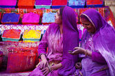 Lady in violet, covered in paint on Holi festival — Stock Photo