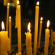 Close up view of the candles cutting through the darkness.  — Foto de Stock