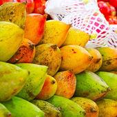 Close up of tasty mango on market stand, India — Stock Photo