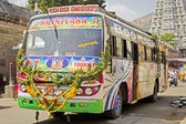 Typical, colorful, decorated public transportation bus in Tiruvanamalai — Foto de Stock