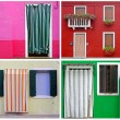 Colorful buildings in Burano island sunny street , Italy — Stock Photo #25622461