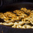 Cooking famous Indian sweet jalebi — Stock Photo