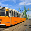 Tram coming from Freedom bridge, Budapest, Hungary — Stock Photo #26892269