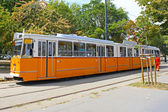 Orange tram on the street of Budapest, Hungary — Stock Photo