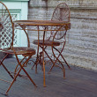 Stock Photo: Metal table and chair in street coffee-bar