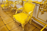 Elegant sofa of yellow chamois — Stock Photo