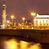 Rostral columns in night Petersburg, Russia — Stock Photo