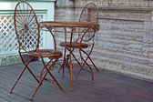 Metal table and chair in street coffee-bar — Stock Photo
